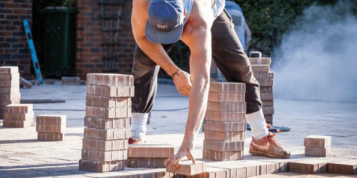 men laying patio paving