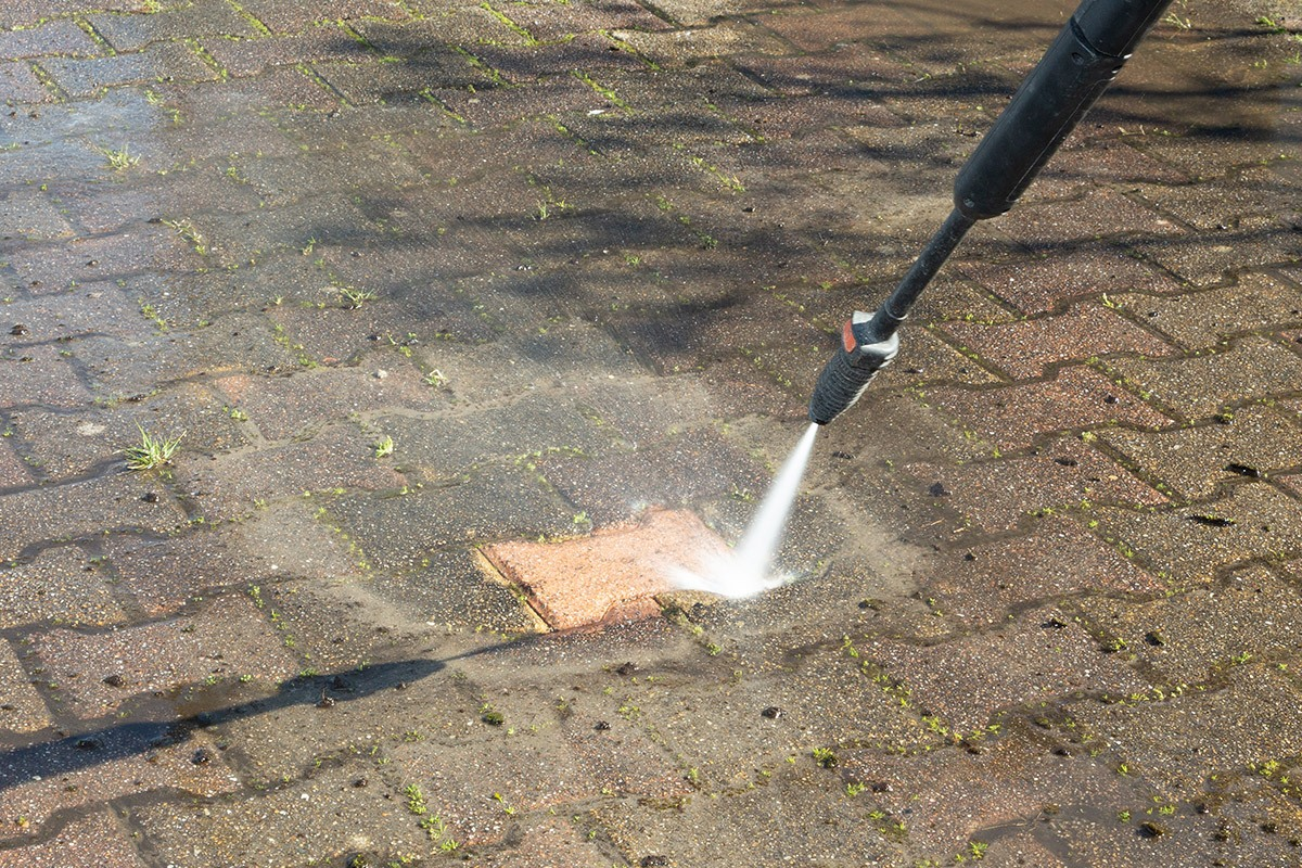 Pressure Washer Cleaning Block Paving Driveway